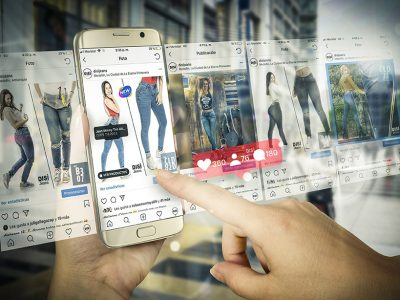 Online shopping with smart phone. Phone in woman hand. Buying wo